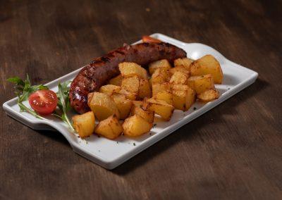 Butifarra con patatas fritas o bravas | Restaurante Centdinou 119 Platja d'Aro